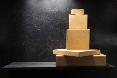cardboard boxes on wooden shelf