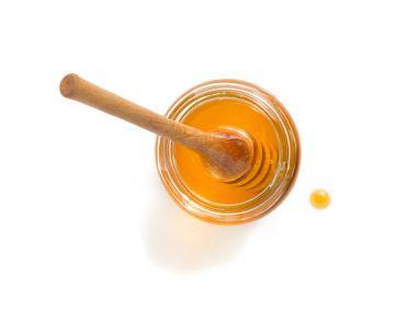 jar of honey on white background