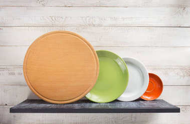 plate at shelf on white wooden background