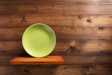 plate at kitchen wooden shelf at wall
