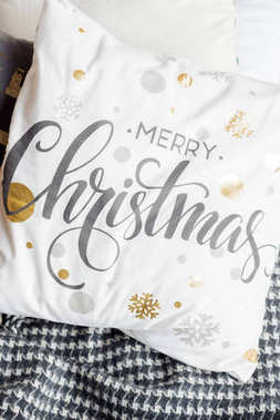 A beautiful white pillow with the inscription Merry Christmas