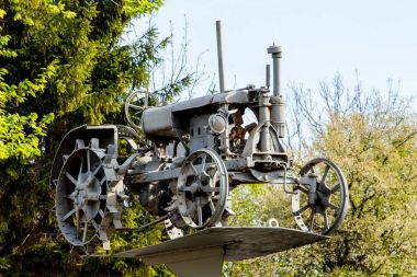 Old tractor on  pedestal in the open-air museum_