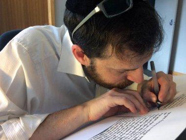 Sofer writes a sefer Torah
