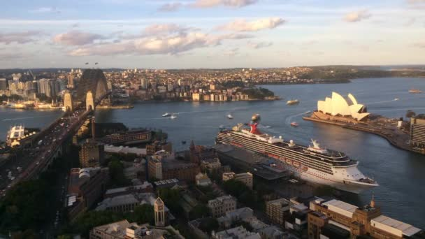 Time lapse Aerial landscape view of Sydney Harbor with Sydney Harbour Bridge, Sydney Opera House, Circular Quay Cove and The Rocks at dusk in New South Wales, Australia.