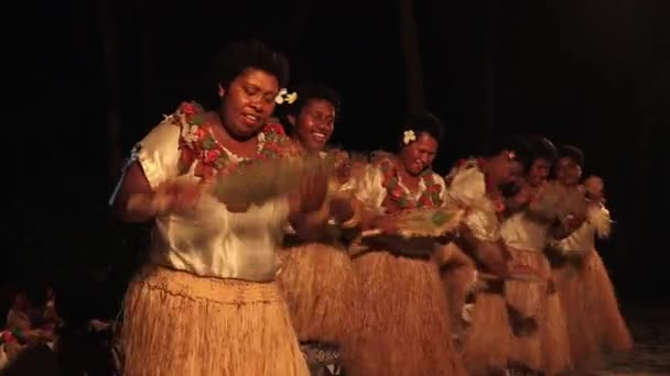Indigenous Fijian women dancing the traditional Meke female dance