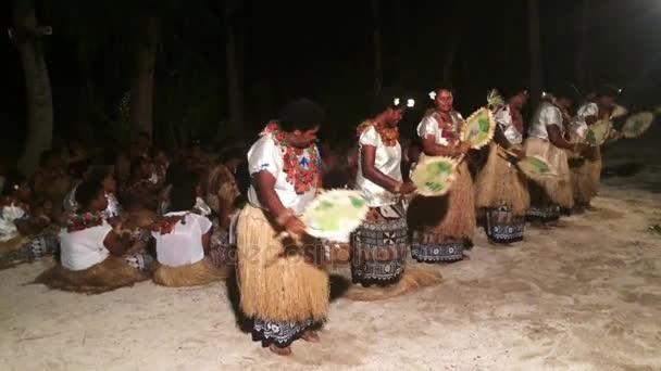 Indigenous Fijian women dancing the traditional Meke dance