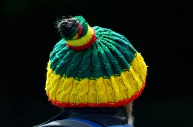 Man wearing a Bob marley hat