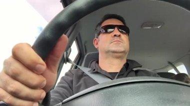 Adult man (age 45) driving a car time lapse
