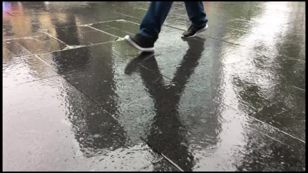 Cinemagraph man walks in the rain