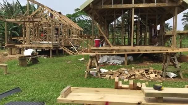 Cook Islanders building a new home in Rarotonga island Cook Islands
