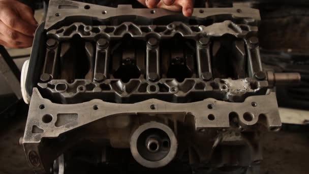 craftsman in car repair shop fixes cars, view of car parts images