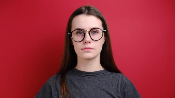Closeup portrait woman in glasses looking surprised in full disbelief wide open mouth and clapping his hands isolated red background. Positive human emotion facial expression body language.