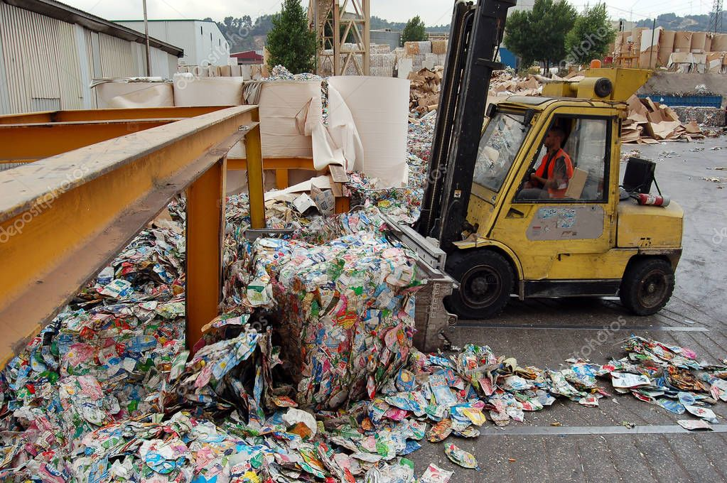 Loading of sorted garbage at the waste processing plant. Packaging and paper.