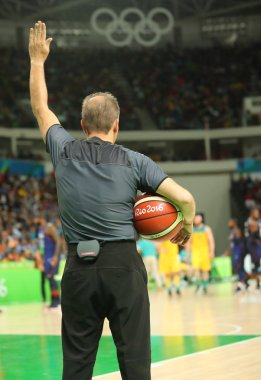 Basketball referee in action at group A basketball match between Team USA and Australia of the Rio 2016 Olympic Games