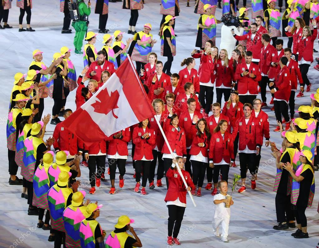 Olympic champion trampoline gymnast Rosie MacLennan carrying Canadian flag leading the Olympic team Canada in the Rio 2016 Opening Ceremony
