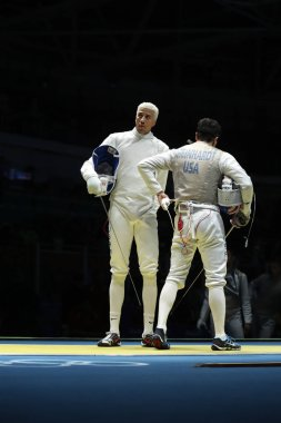 Fencers Miles Chamley-Watson (L) and Gerek Meinhardt of United States compete in the Men's team foil of the Rio 2016 Olympic Games at the Carioca Arena 3
