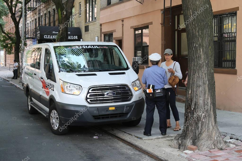 NYPD traffic control officer argues with driver about parking violation in Lower Manhattan