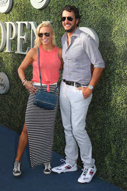 American country singer and songwriter Luke Bryan and Caroline Boyer on the blue carpet before US Open 2017 opening night ceremony