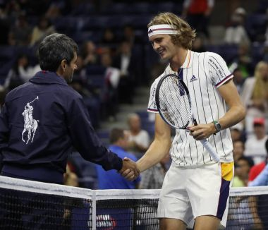 Tennis umpire Carlos Ramos of Portugal (L) and professional tennis player Alexander Zverev of Germany before 2017 US Open first round match