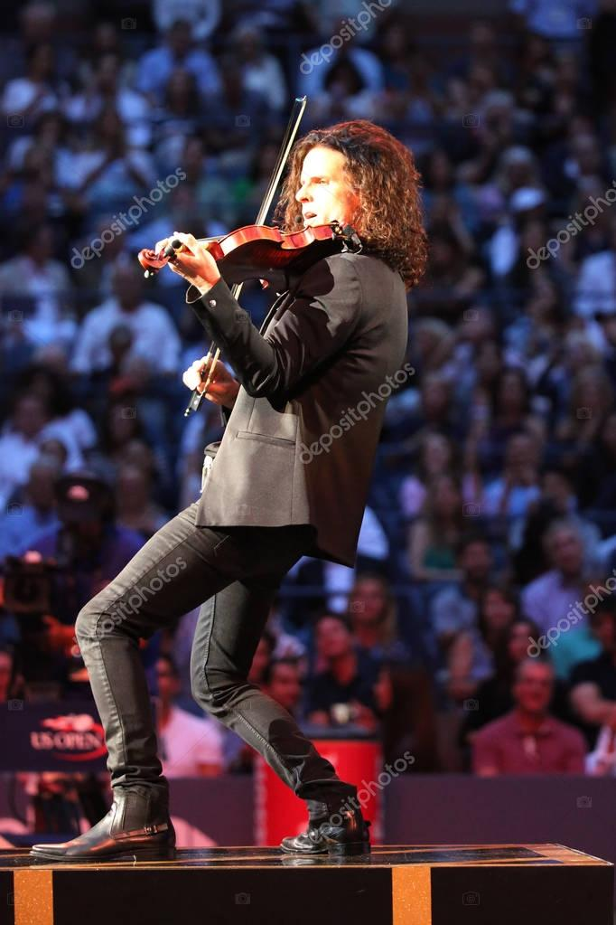 Violin player plays during Canadian country singer and songwriter Shania Twain performance at 2017 US Open opening night ceremony
