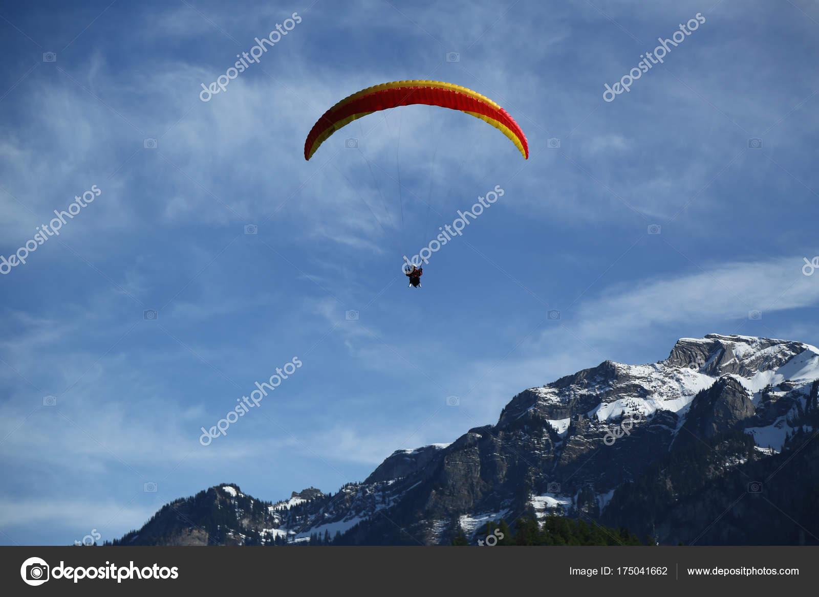Interlaken switzerland may 2017 tandem paragliding flights swiss interlaken switzerland may 2017 tandem paragliding flights swiss alps interlaken stock photo publicscrutiny Gallery