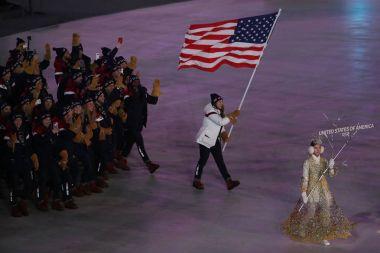 PYEONGCHANG, SOUTH KOREA  FEBRUARY 9, 2018: Olympic champion Erin Hamlin carrying the United States flag leading the Olympic team USA the PyeongChang 2018 Olympics opening ceremony