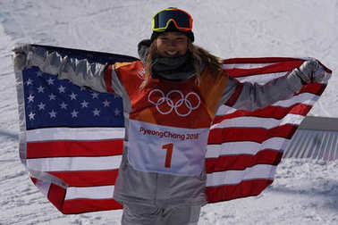 PYEONGCHANG, SOUTH KOREA  FEBRUARY 13, 2018: Olympic champion Chloe Kim celebrates victory in the women`s snowboard halfpipe final at the 2018 Winter Olympics in Phoenix Snow Park in PyeongChang