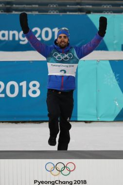 PYEONGCHANG, SOUTH KOREA  FEBRUARY 18, 2018: Olympic champion Martin Fourcade of France celebrates victory in biathlon men's 15km mass start at the 2018 Winter Olympics in Alpensia Biathlon Centre