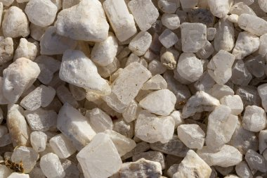Quartz is a hard, crystalline mineral. White transparent pebbles, for decorating exteriors.