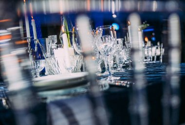 table decorated with crockery glasses and candles