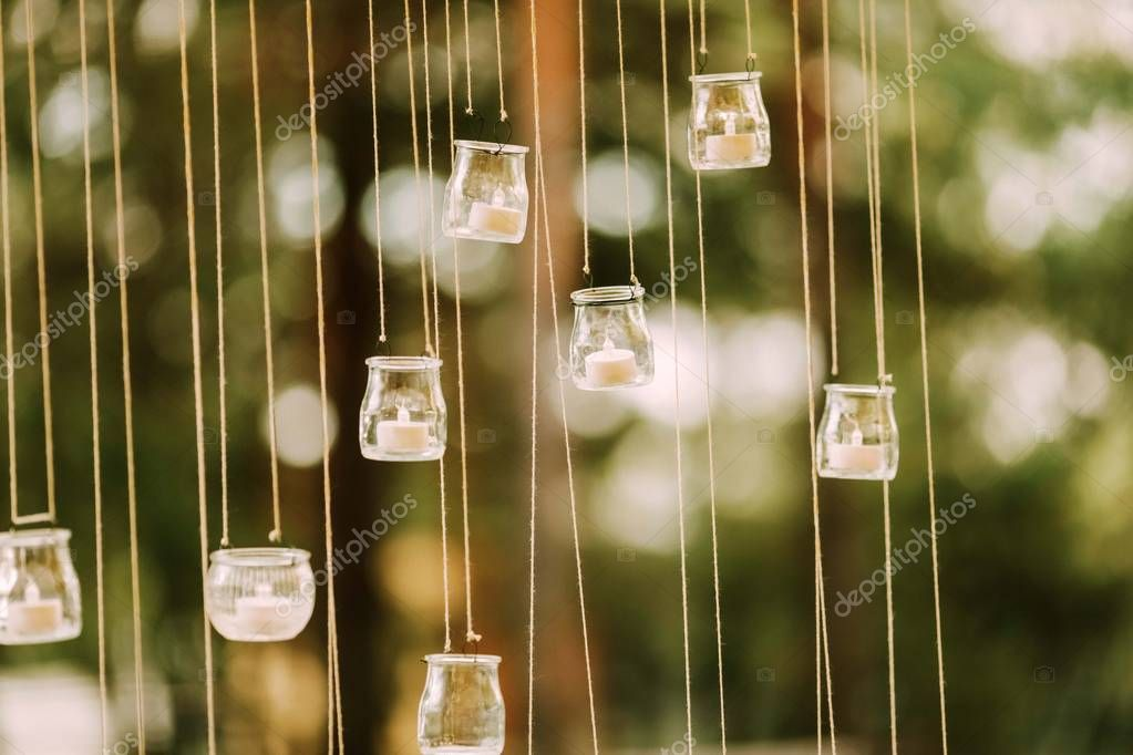 Wedding decor candles glass flasks forest