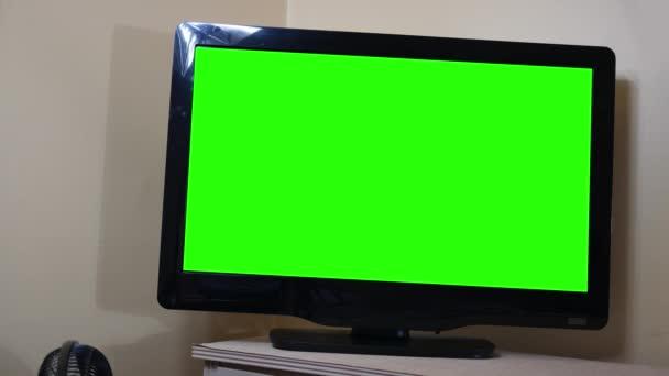 Zelená obrazovka Hd Tv ležela prádelník