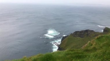Facing North Atlantic Ocean from the Cliffs of Moher in Ireland