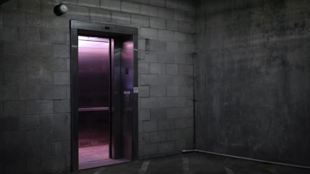 An Elevator door closes in the basement ground level of dark parking garage\u2013 stock footage & Elevator Door Closes Basement Ground Level Dark Parking Garage ...