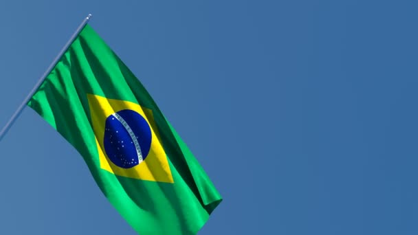The national flag of Brazil is flying in the wind