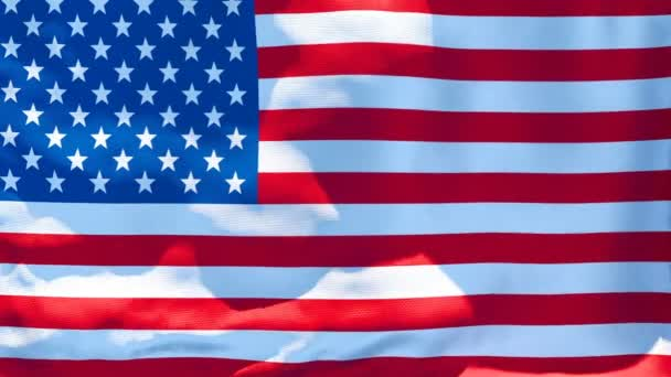 The national flag of the United States of America is flying in the wind