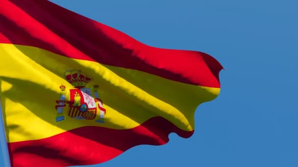 The national flag of Spain is flying in the wind