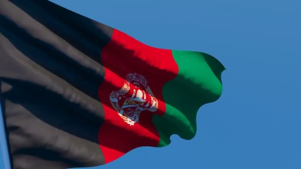 The national flag of Afghanistan is flying in the wind
