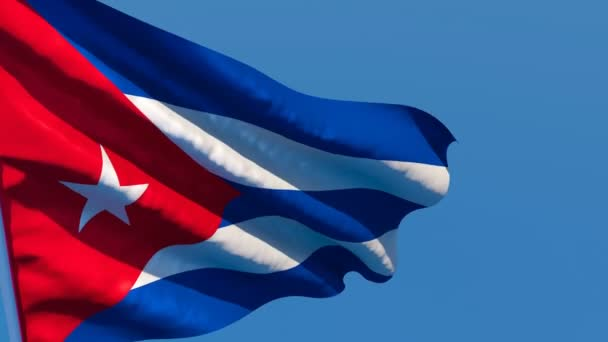 The national flag of Cuba is flying in the wind