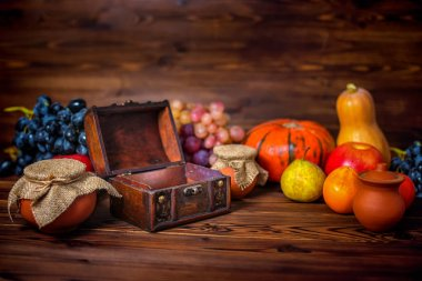 Thanksgiving holiday background with opened chest treasure, appl