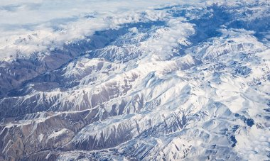 view of airplane wtop view of Afghanistan mountains covered with