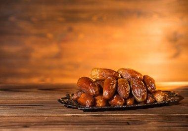 dates on tray, evening scene, concept of  Ramadan Kareem, copy s