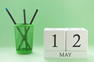 Desk calendar of two cubes for May 12