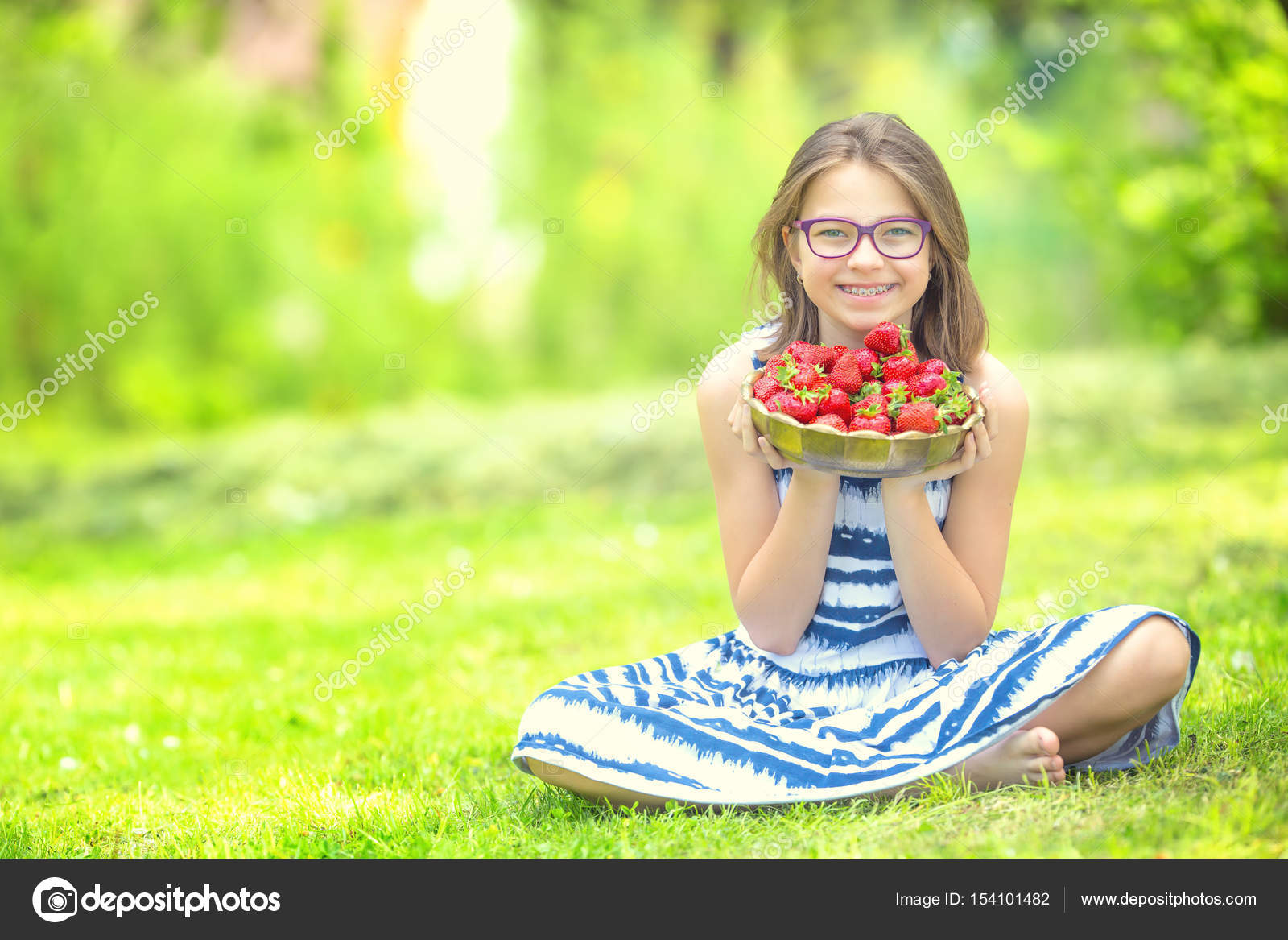 surprising Cute Little Teen Part - 20: Cute little girl with bowl full of fresh strawberries. Pre - teen girl with  glasses