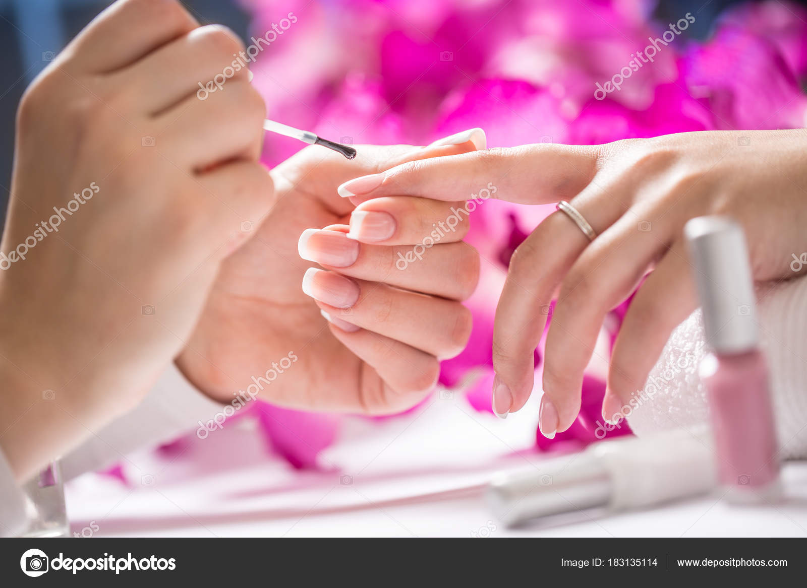 Manicure specialist painting woman gel nail. Art - French manicure ...