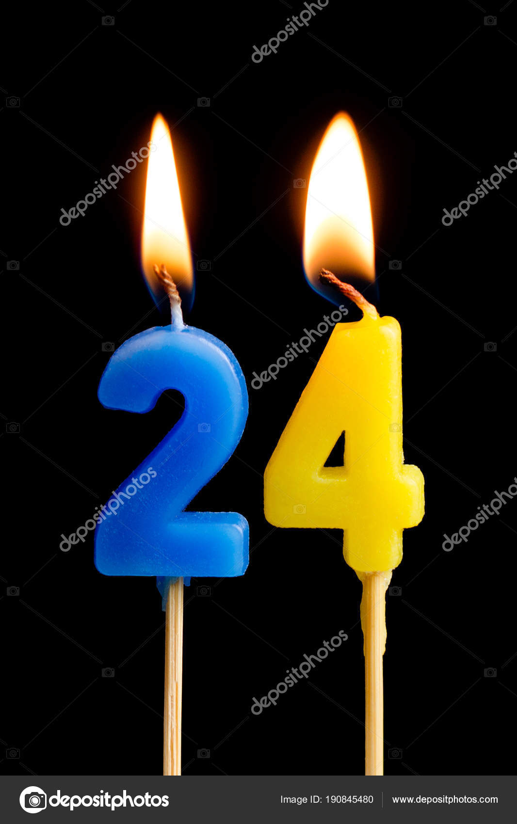 Burning Candles In The Form Of 24 Twenty Four Numbers Dates For Cake Isolated On Black
