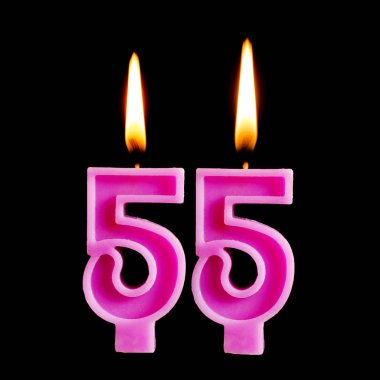 Burning candles in the form of 55 fifty five for cake isolated on black background. The concept of celebrating a birthday, anniversary, important date, holiday