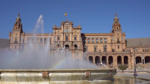 Seville,Spain-august 7,2017:Horse-drawn carriages take tourists on a visit to the famous Plaza de Espana in Seville during a summer day
