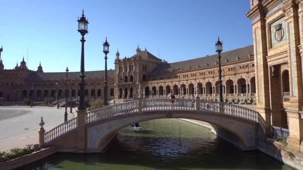 Seville,Spain-august 7,2017:tourists stroll and admire the famous plaza de Espana in Seville during a sunny day