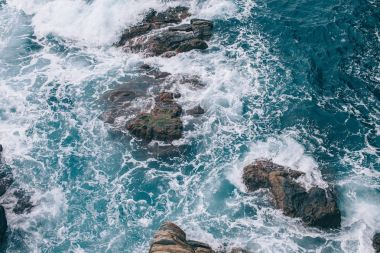 Beautiful wavy sea with cliffs at coastline in Riomaggiore, Italy stock vector